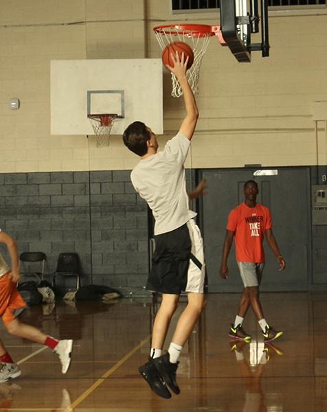 Senior Jack Myers shoots a lay-up in a practice last week in the Aux gym.