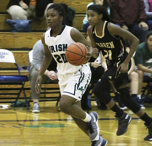 During the Warren Central game on Nov. 8, a 49-44 loss to the Warriors junior Keya Patton brings the ball up the court. Patton scored 26 of the team's 44 points and is averaging 22.6 points per game.