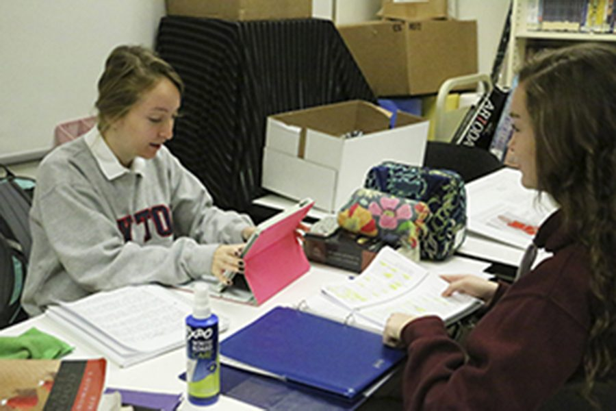 "Seniors Maria Carlson and Sarah Collins study during flex on Nov. 28. School counselor Mrs. Gretchen Watko '01 said, ""Finals can be a great way to boost your grade. It could make it or break it for the semester grade."""