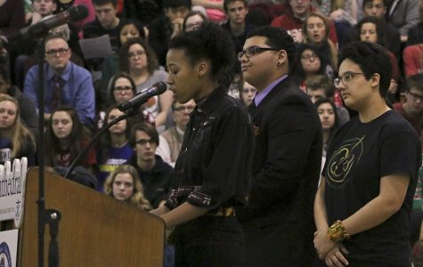 Senior Michaela Ivory, junior Caige Harris and senior Bella Thomas present on the black influence on literature in the Black History Month Assembly during flex on Tuesday. There were several key African American authors discussed, including W.E.B. Du Bois, author of The Souls of Black Folk, and Alex Haley, the author of Roots.