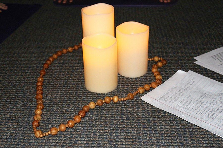 To grow closer to God, students participate in SoulCore circled around a rosary and candles.
