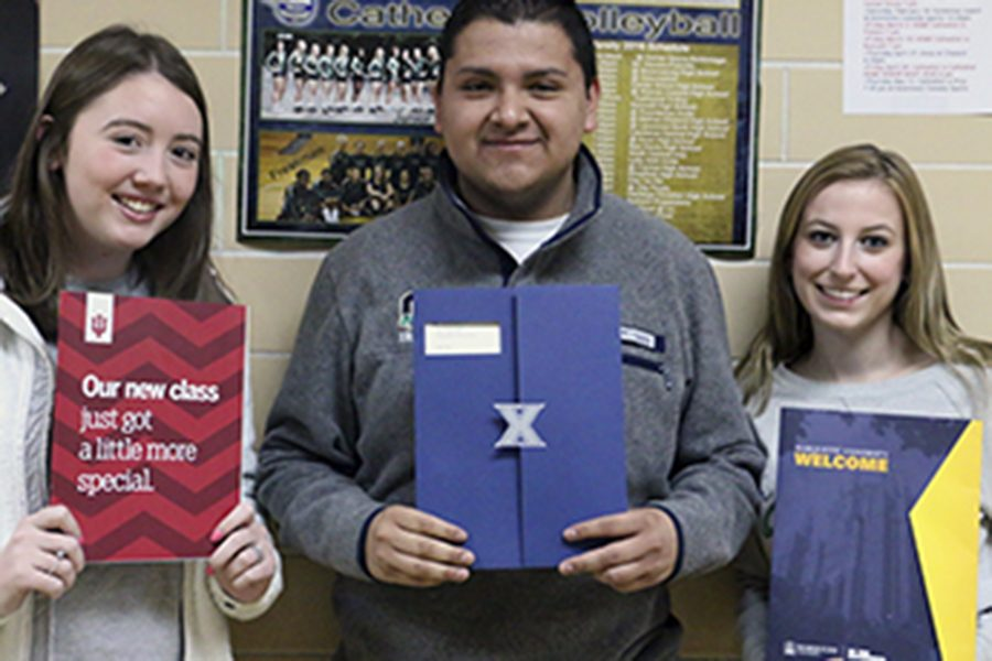 Seniors Sarah Bertrand, Alan Lozano and Lauren Buday hold up their acceptance letters to Indiana University, Xavier University and Marquette University during Flex on March 17.