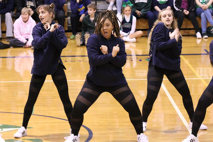 Seniors Elise Cassidy and Sydney Giles and junior Sarah Schildmeyer perform at Winterfest on Feb. 10.