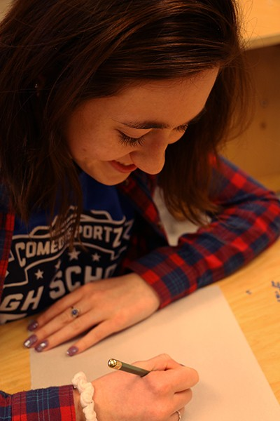 Senior Sophia Mathioudakis writes calligraphy on Feb. 3 during Flex.