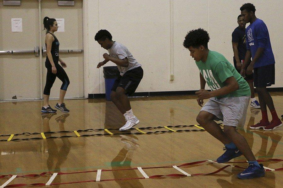 During Tuesday morning's speed school, participants, including freshman Shiloh Means (in the green T-shirt), take part in the ladder drill, the purpose of which is to improve footwork.