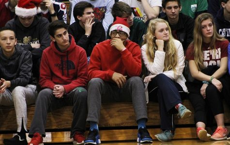 """Students dress up for """"Holidaze Tuesday"""" while they wait for the Black History Month Assembly to begin."""