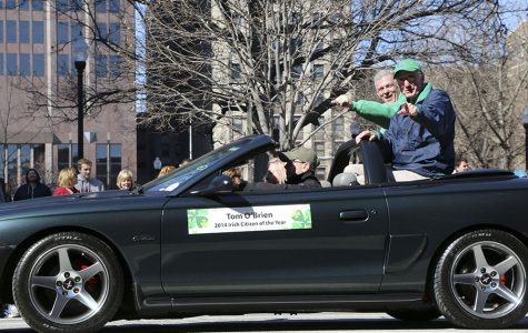 "Mr. Tom ""Super Sub"" O'Brien '49 and  Principal Mr. Dave  Worland ride in the 2015 St. Patrick's Day Parade. O'Brien was named Irish Man of the Year for 2014. Along with this award,  many students participate in the parade in some way."
