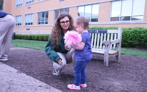 Senior Isabel Cavosie plays with one of the children during the annual AP Psychology daycare.