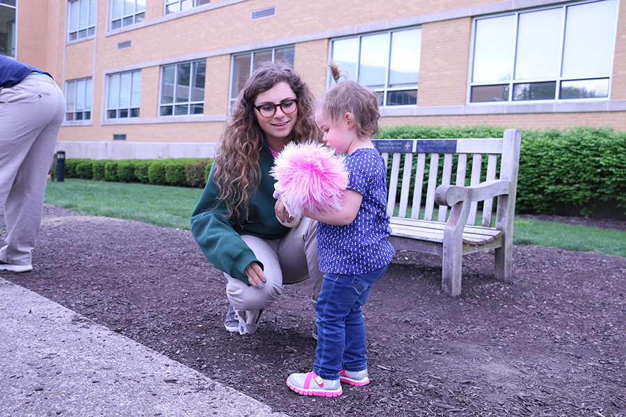 Senior+Isabel+Cavosie+plays+with+one+of+the+children+during+the+annual+AP+Psychology+daycare.%0A
