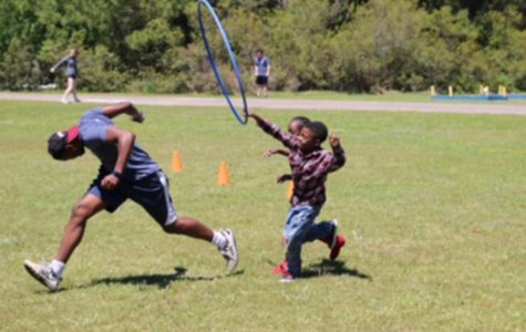 Students set up and participated in a field day at an elementary school on their last full day in South Carolina.