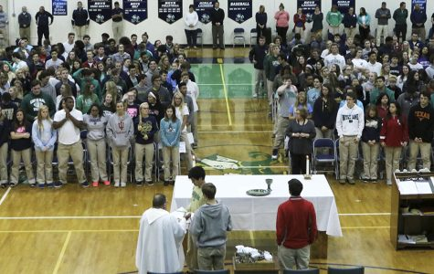 The Senior class joins in a sending off mass.