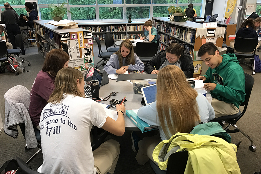 As final exams approach, the library is a popular place for study groups to meet.