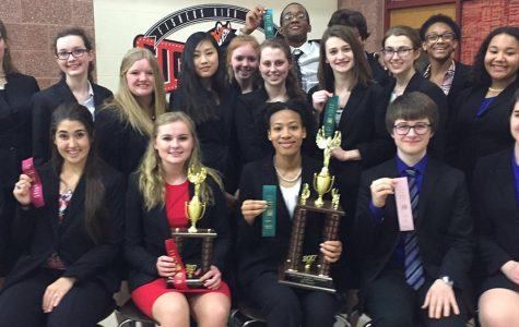 Several members of the speech and debate team show up their ribbons and trophies at last year's State meet.