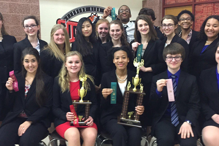 Several+members+of+the+speech+and+debate+team+show+up+their+ribbons+and+trophies+at+last+year%27s+State+meet.