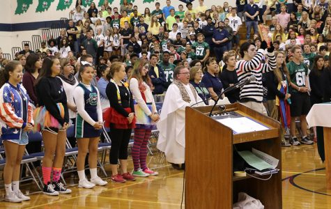 Surrounded by members of the liturgy planning committee, Fr. John Zahn celebrates Mass in the Welch Activity Center at the beginning of the 2016-2017 school year.
