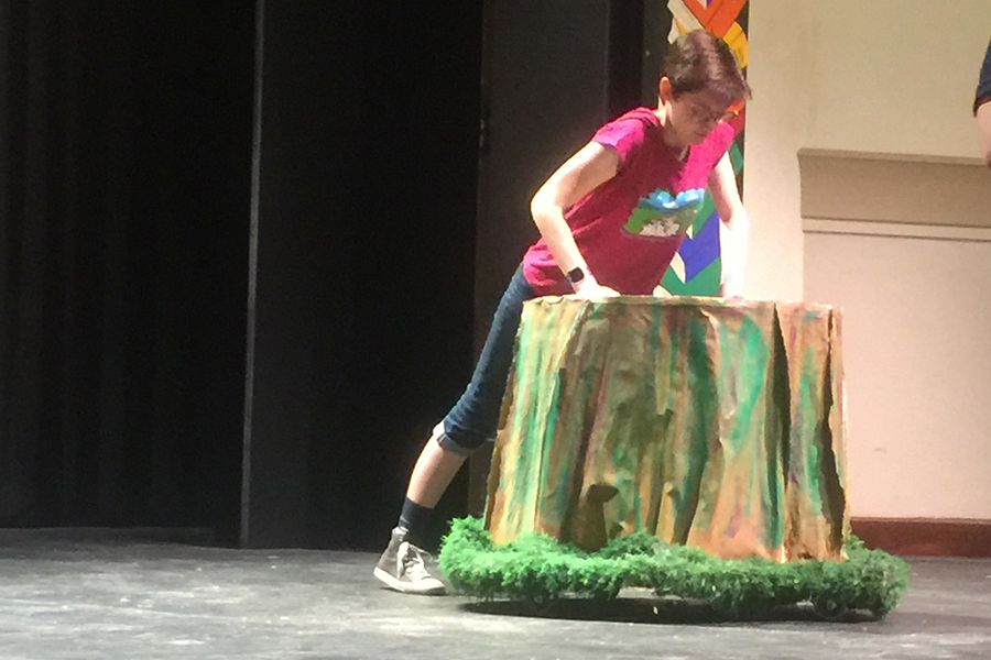 Senior Lillian Moffatt, one of the two student directors, stages a tree stump during the Sept. 21 rehearsal.