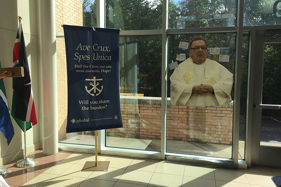 Fr. John Zahn's image graces the atrium outside the auditorium. His funeral is Sept. 6 at the cathedral in Lafayette.
