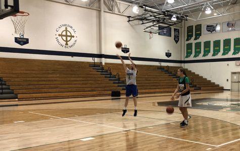 Oct. 27 after school, freshman Kieran McCauley shoots free throws in the Welch Activity Center.