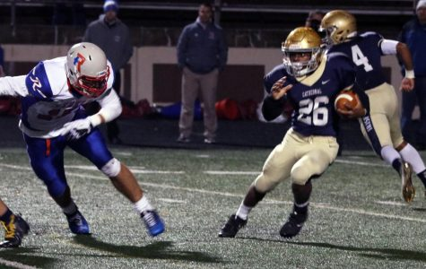 Running back junior Chon'Dre Bissell (26) gains yardage in the 28-23 Sectional victory over Roncalli after taking the handoff from quarterback sophomore Roman Purcell (4). The Irish take on Decatur Central Nov. 3 at 7 p.m. at Arsenal Tech for the Sectional championship.