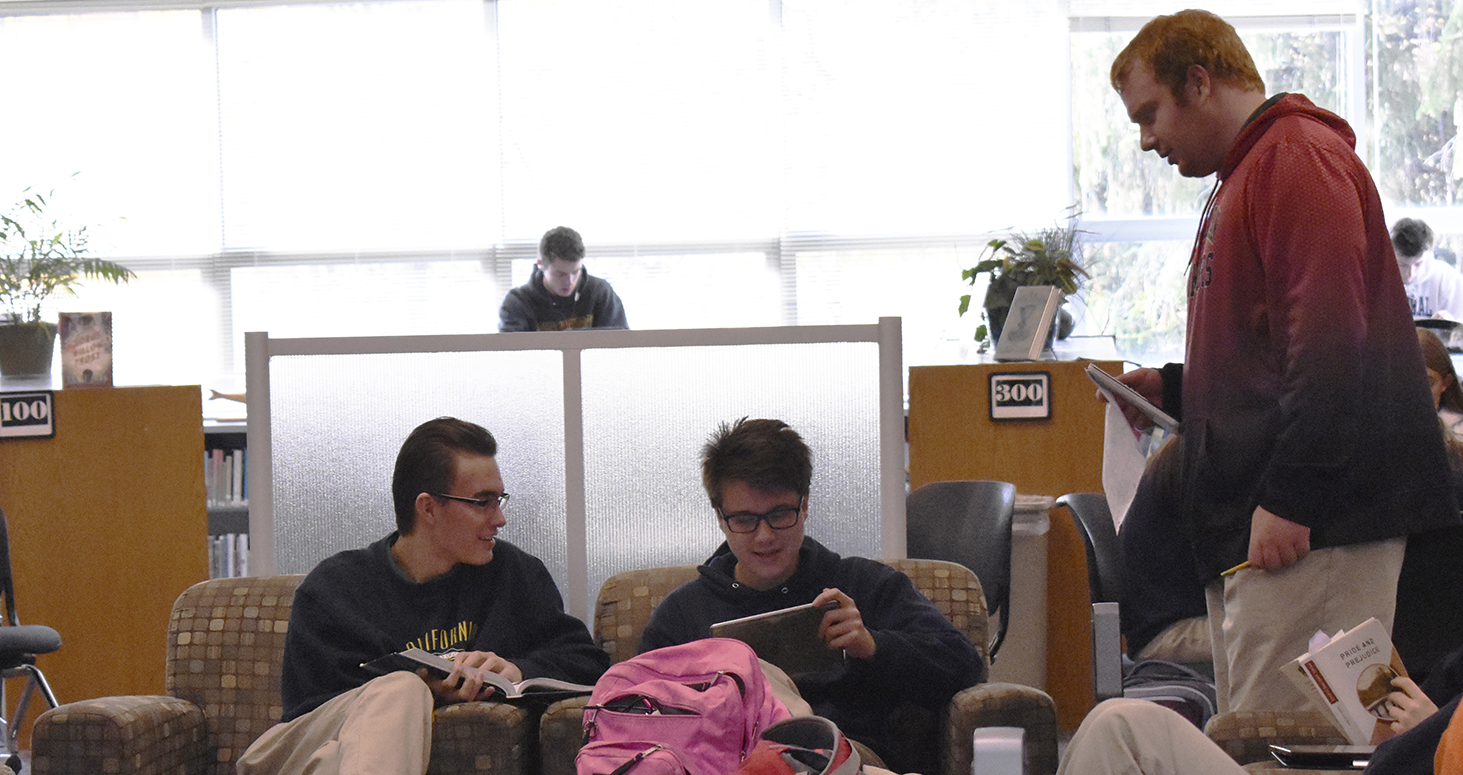 Seniors David Bishop, Nicolas Widel and Daniel Willey work on their iPads.