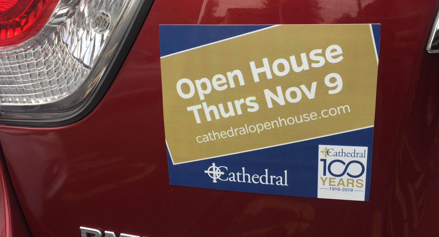 A car in the teacher's lot next to the Welch Activity Center sports a magnet publicizing the Nov. 9 Open House.