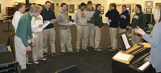 Irish Guys with Ties, during rehearsal sans ties, prepares for their Christmas concert debut.