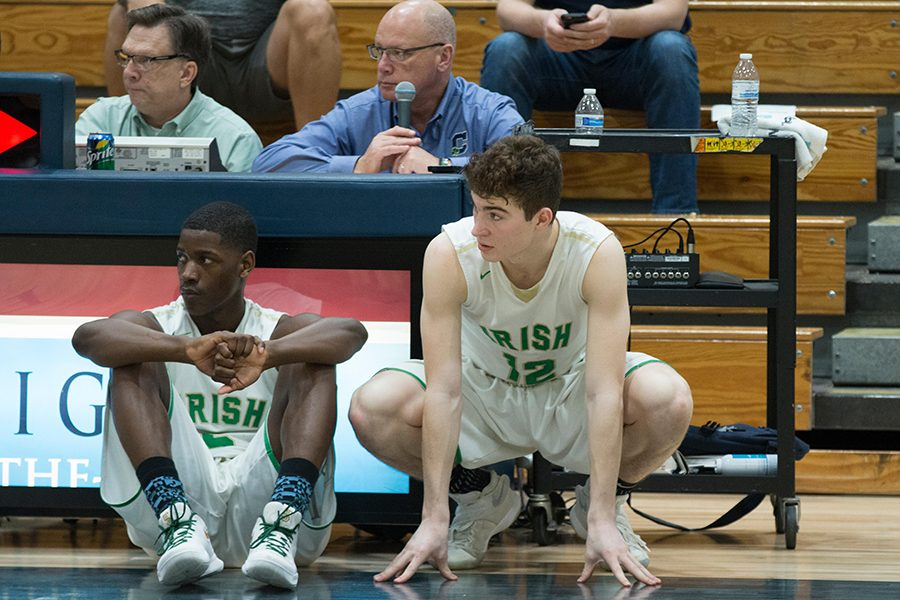 During the varsity's Feb. 19 game against Lighthouse Christian Academy, seniors Jayden Edwards and Jacob Ball wait to check it. The team will open Sectional play on Feb. 27.