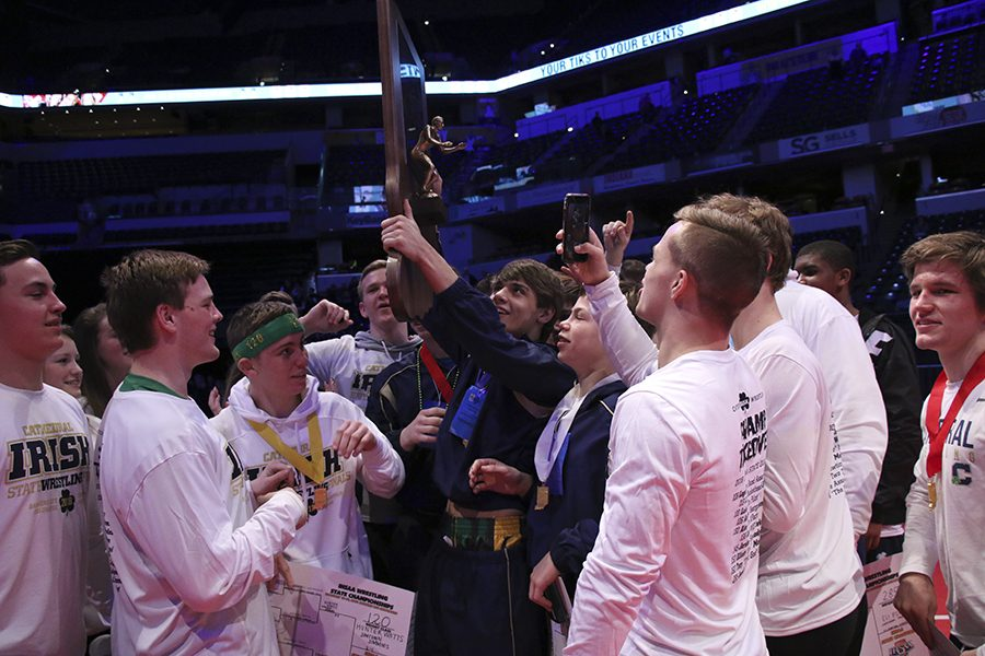 The+Irish+wrestlers+raise+the+State+championship+trophy+Feb.+17+at+Bankers+Life+Fieldhouse.+