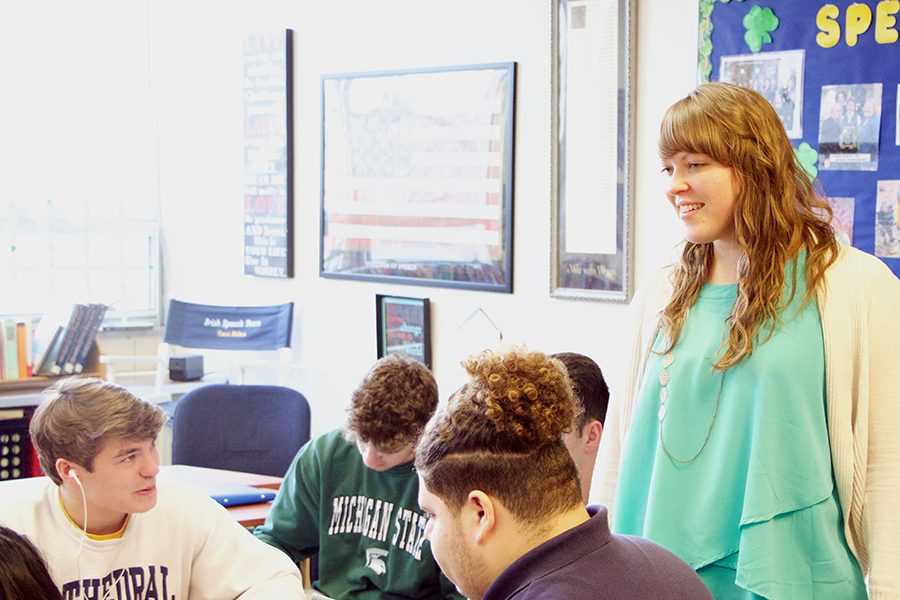 Theology teacher Ms. Katie Klee interacts with students in her E period class. She also teaches Confirmation classes at Pendleton.