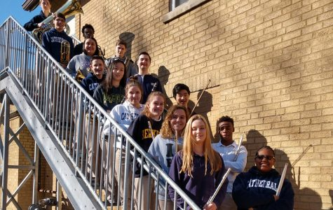 Pride of the Irish members who participated in the state school music contest on Feb. 24 stand on the stairs outside Cunningham.
