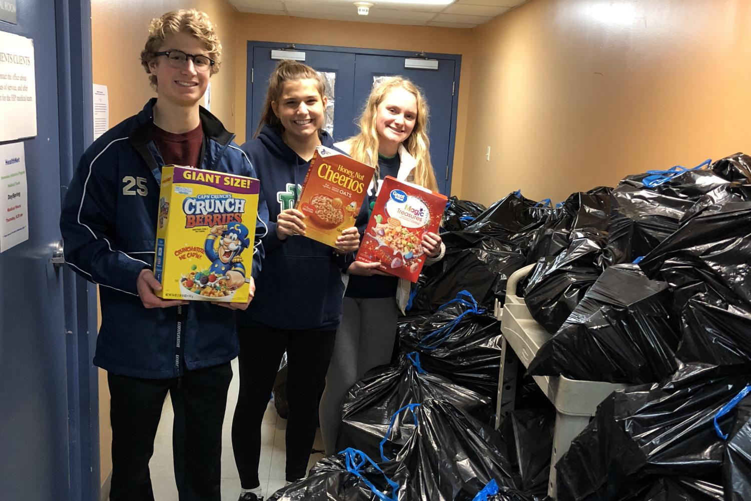 Students pose with the heaps of collected cereal.