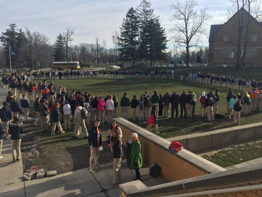 Walkout participants gather in prayer circle in support of both Stoneman Douglas and gun reform.
