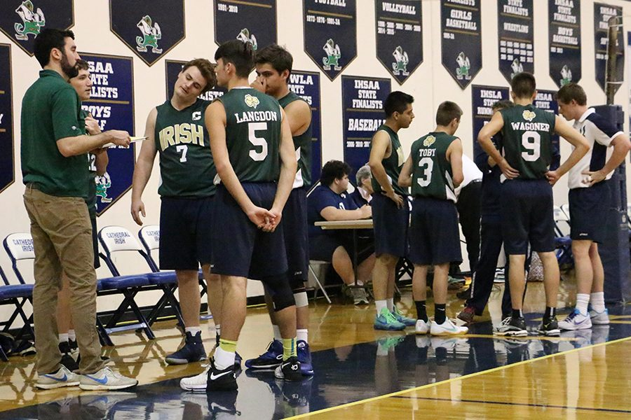 Members of the men's volleyball team, shown during a timeout last season, will host a Pre-St. Patrick's tournament in the Welch Activity Center on March 10.