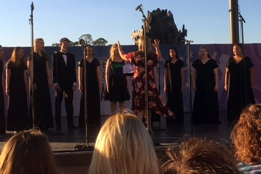 The choir, under the direction of Mrs. Marian Bender, performs in Disney Springs.