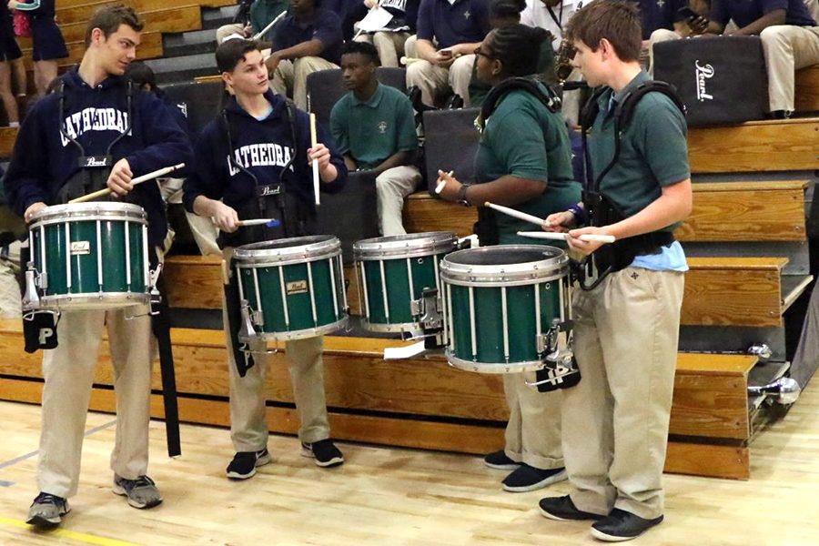 The+percussionists%2C+performing+during+a+basketball+game+in+the+Welch+Activity+Center%2C+will+take+their+show+on+the+road+when+the+Pride+of+the+Irish+performs+in+the+St.+Patrick%27s+Day+parade.+