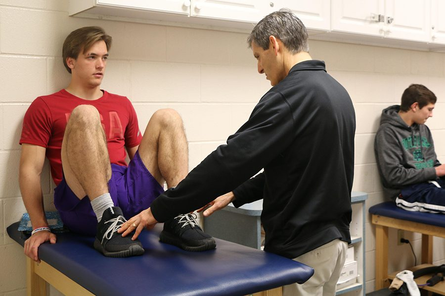 Athletic+trainer+Mr.+Mike+Hunker%2C+assisting+junior+John+Leffel%2C+will+return+for+campus+next+year%2C+along+with+health+professionals+from+the+Community+network.+