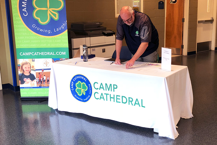 On July 25 in the Shiel Student Life Center, Camp Cathedral director Mr. Anthony Ernst prepares to check in that morning's participants.