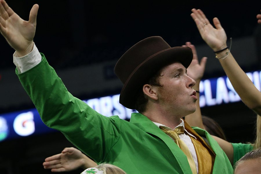 Senior Michael McNulty, in his leprechaun finest, fires up the crowd at Lucas Oil Stadium during the football teams 31-7 win over Noblesville.