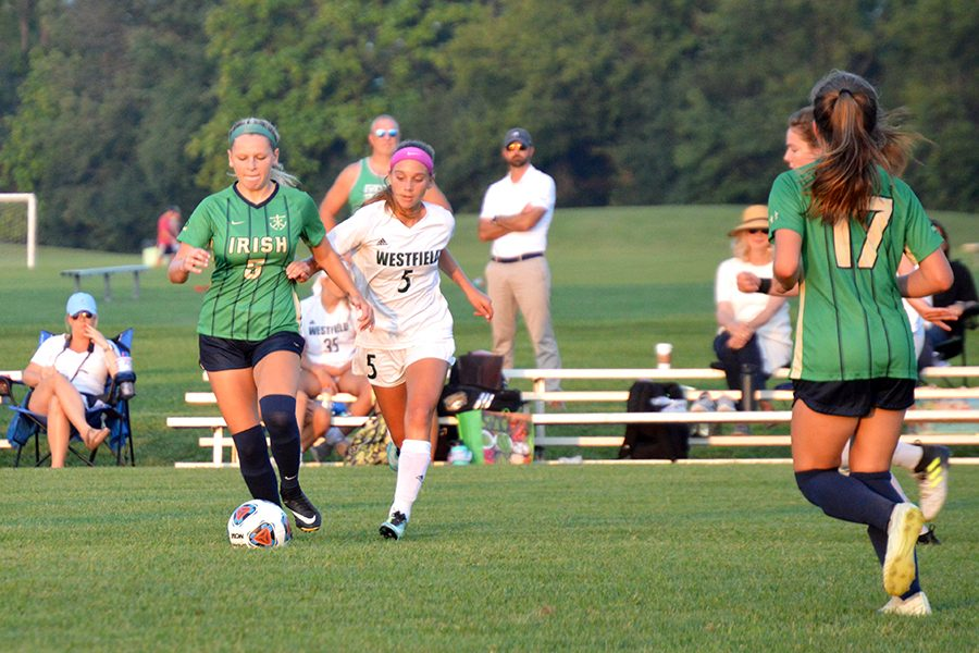 The women's soccer team takes on Westfield during a match earlier this season.