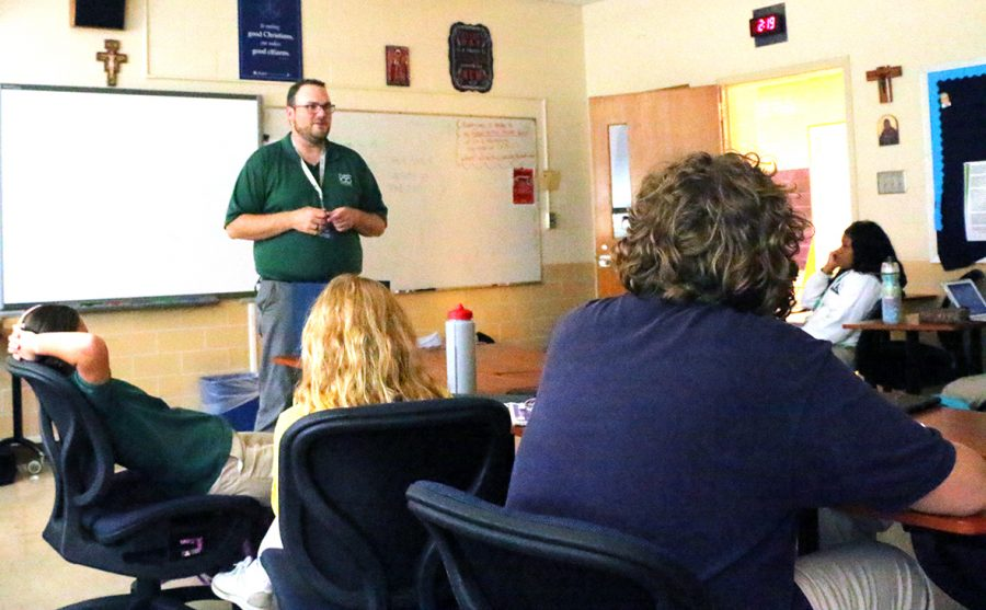 Theology+teacher+Mr.+Matt+Cannaday+leads+a+discussion+in+a+religion+class.+