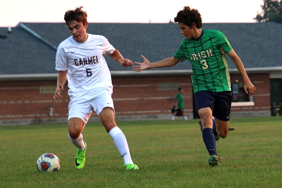The men's soccer team, shown in action earlier in the season against Carmel, opens Sectional play on Oct. 3.
