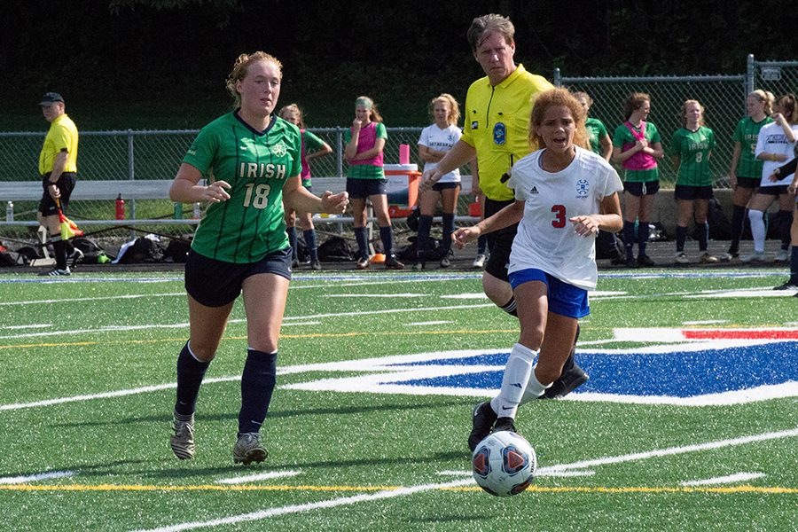 The women's soccer team, shown in action earlier this season, takes on Evansville Memorial on Oct. 20 for the Semistate championship.