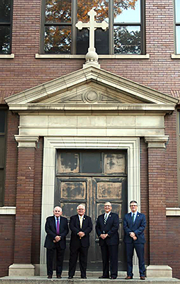 All four school presidents n Cathedral's history stood on the same spot where a photo taken 100 years before marked the opening of the school.