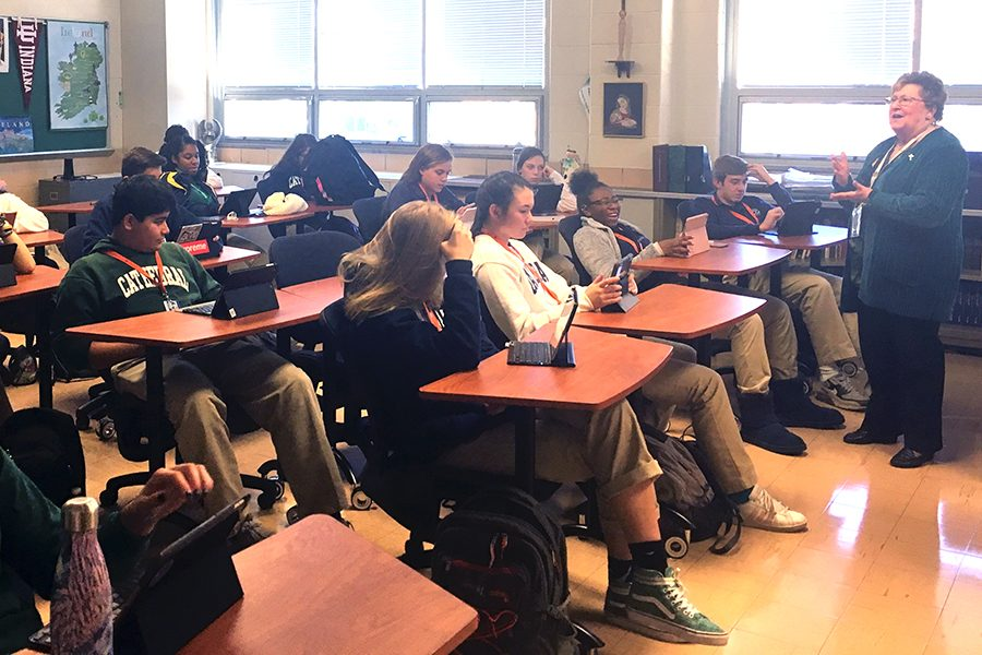 Sr. Mary Ann Stewart instructs her G period history class on Oct. 17. Sr. Stewart said she encourages all students who registered to vote to cast their ballot on Nov. 6.