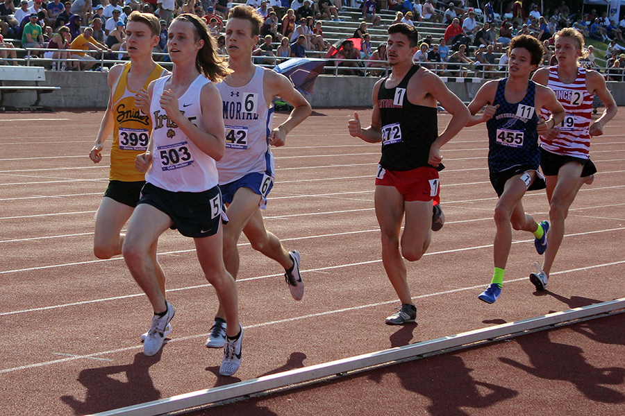 Senior Cole Hocker, second from left, runs in the State track meet last June at Indiana University.