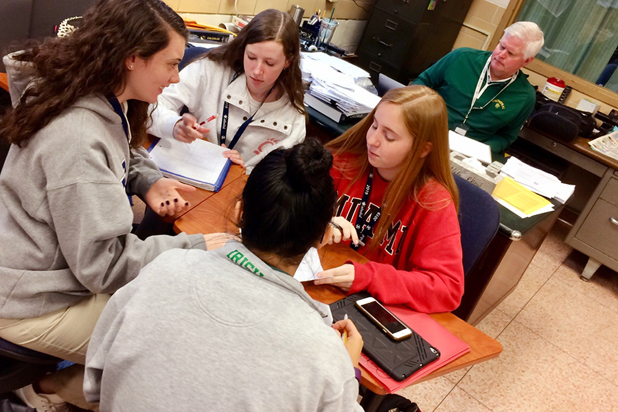 During Mr. Rick Shadiow's math classroom in Kelly Hall, seniors Katie Kelly, Cami Cerefin, Sarah Hoffman and Kate Albean study for their next test.