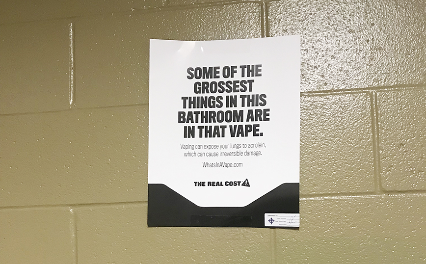 To deter use of the Juul, the school has put up posters by multiple bathrooms to inform students of risks associated with vaping.
