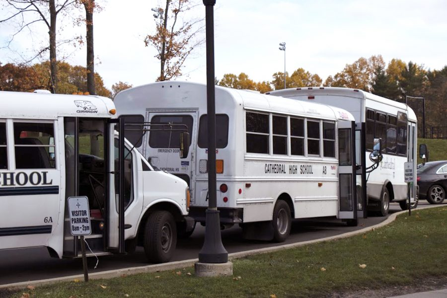 Buses prepare to load students for their trip home. Those buses will make frequent stops, and it's not uncommon for drivers to illegally pass, according to Mr. Ken Kaufman, director of transportation.