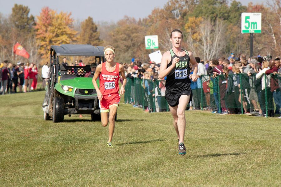 Senior Cole Hocker gets out to a solid lead at the State cross-country meet. Hocker went on to finish first with a time of 15:25.1.