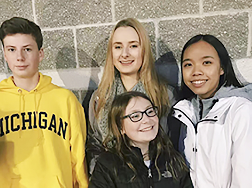 Senior+Angel+Luo+stands+outside+of+Target+on+Black+Friday+with+senior+Anna+Pohl+and+sophomore+Alex+Pohl.+The+Pohls+hosted+Luo+last+year%2C+and+they+celebrated+Thanksgiving+together.+%0A